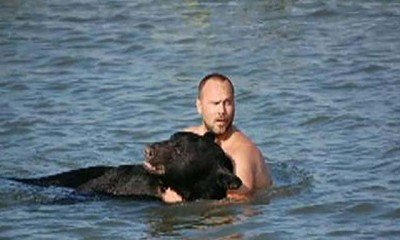 Man risks life to save bear
