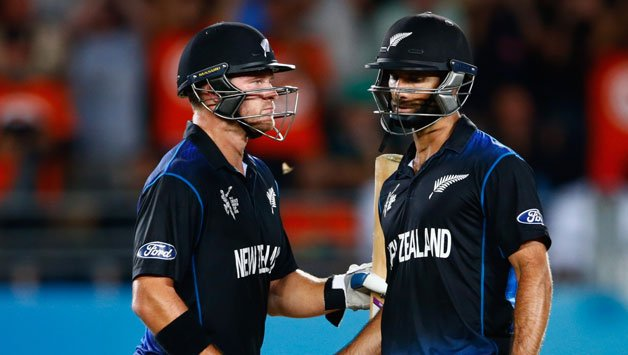 Grant-Elliott-of-New-Zealand-makes-his-50-runs-R-and-is-congratulated-by-Corey-Anderson41