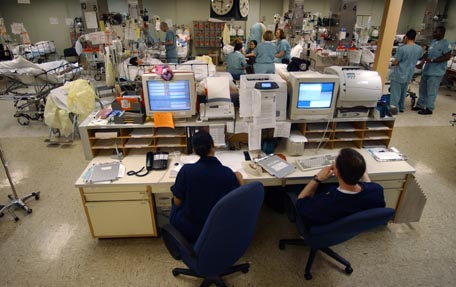 030423-N-6967M-090 Aboard USNS Comfort (T-AH 20) Apr. 23, 2003 -- A central computer system monitors the heart rates of each patient in the Intensive Care Unit (ICU) to ensure a quick response to any problems that may occur while aboard USNS Comfort (T-AH 20).  Comfort is one of two hospital ships operated by Military Sealift Command and is designed to provide emergency, on-site care for U.S. combatant forces deployed in war or other operations.  USNS Mercy (T-AH 19) and Comfort each contain 12 fully-equipped operating rooms, a 1,000 bed hospital facility, digital radiological services, a diagnostic and clinical laboratory, a pharmacy, an optometry lab, a cat scan and two oxygen producing plants.  Both hospital ships are converted San Clemente-class super tankers.  Comfort set sail for New York City and provided housing, laundry, food, medical and other services to volunteers and rescue personnel for nearly three weeks in the wake of the terrorist attack on the World Trade Center.  Comfort was activated again in December 2002 and sailed to the Arabian Gulf to support Operation Iraqi Freedom, the multi-national coalition effort to liberate the Iraqi people, eliminate IraqÕs weapons of mass destruction, and end the regime of Saddam Hussein. U.S. Navy photo by Photographer's Mate 1st Class Shane T. McCoy.  (RELEASED)