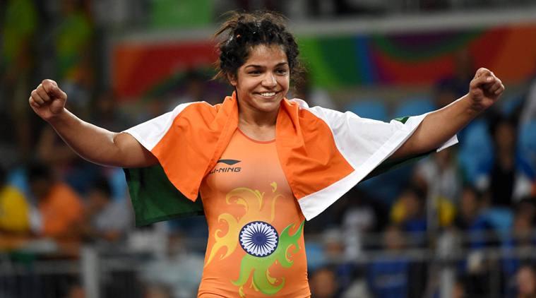 India's Sakshi Malik waves national flag
