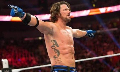 AJ Styles defeated Cena and Ambrose